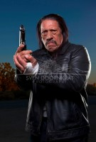 Дэнни Трехо. With a gun