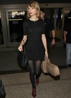 Тейлор в аэропорту Лос-Анджелеса «LAX», США